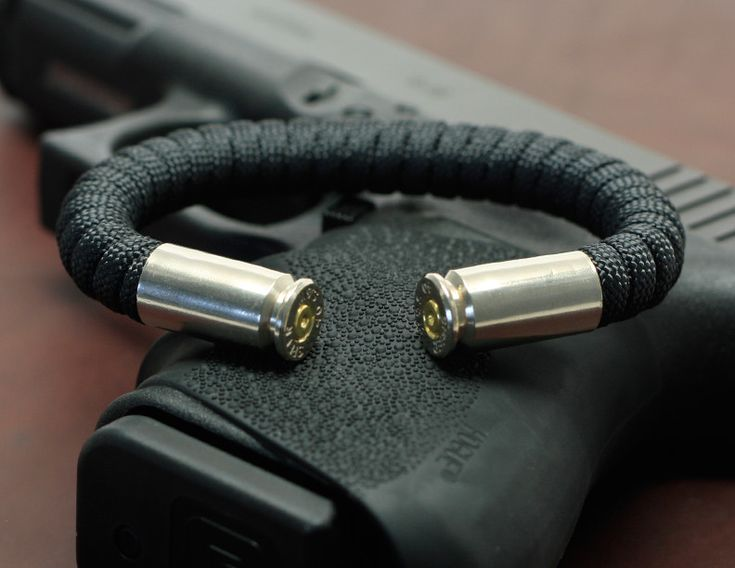 NEW!  Range Master Bullet Bracelet. The Range Master Bullet Bracelet combines classic Survival Straps® paracord with actual spent, recycled, tumbled & polished nickel bullet shell casings. Bracelets are wrapped in super strong paracord, and can be flexed wider or squeezed tight around the wrist for a custom fit. Available in a wide range of colors and 3 shell casing sizes (.40, .45 and 9mm); this hand crafted jewelry is offered in size small, medium or large.
