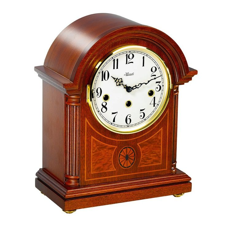 Elegant classic mantel clock with exquisite inlays, glass front with a brass bezel. 4x4 Westminster Chime. 8 day power reserve