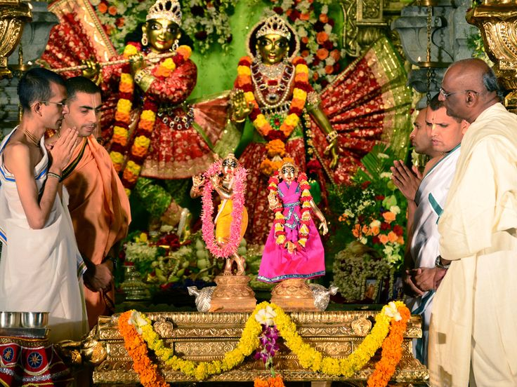 Offering Pooja and Abhishekam to their lordships