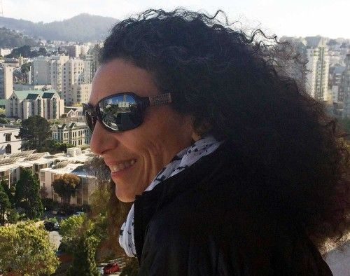 Therese Iknoian wearing the Switch Arya sunglasses looking over the city of San Francisco.