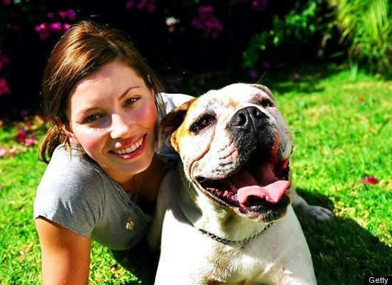 Jessica Biel smiles with her bulldog, East.