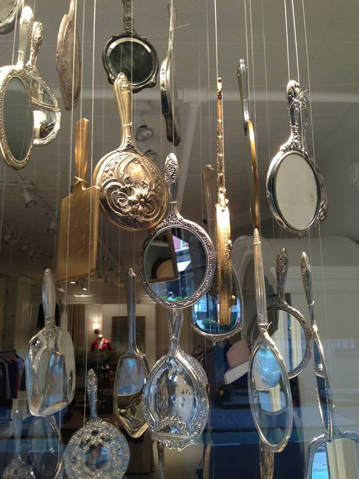 Antique Mirror's as retail window display... from wire grid on ceiling?