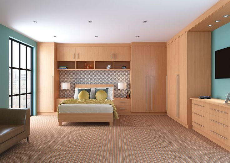 nice! bedroom w maple furniture. w cream instead of teal walls.