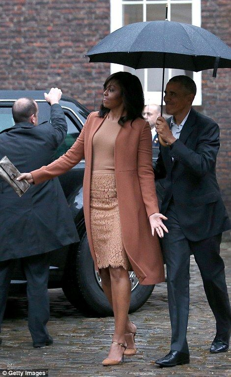 Here we are! Michelle and Barack Obama arrive at Kensington Palace...
