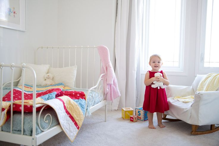 Use a bright little quilt to add a punch of colour to clean and simple decor.  A nursery any little one would love.