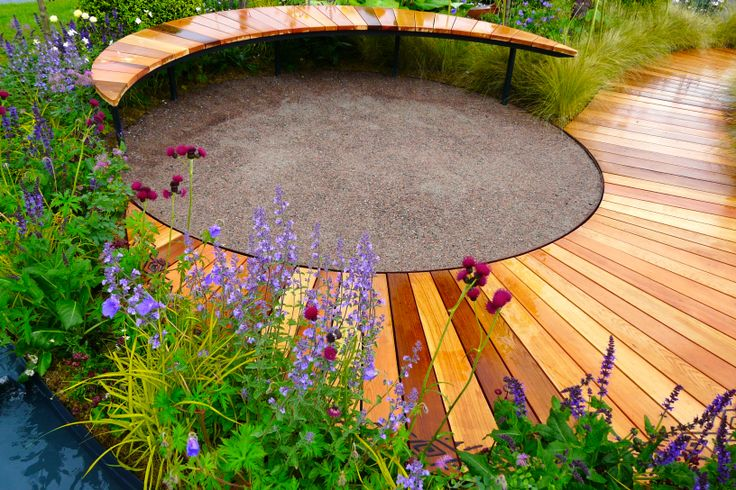 Designed by Carolyn Grohmann. Crescent moon bench, steel edged cedec circle and sweeping cedar boardwalk, built by Kevin Clark.