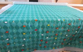 Nope, not a typo (although, I sometimes do get bored while basting, not my favorite part of quilting). I'm constantly looking for new ways t...