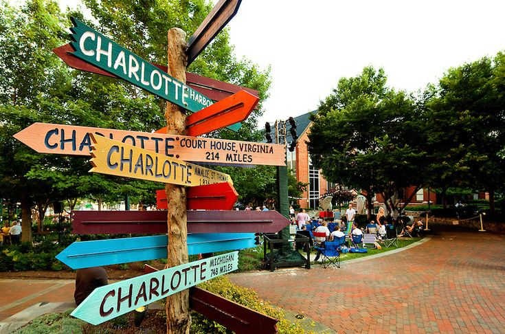 Photo of the iconic Charlotte signs statue/public art located on The Green in Uptown Charlotte. The Green is actually the top level of an underground parking garage.