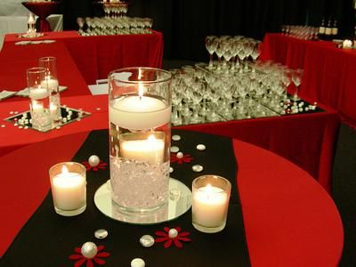 Simple and effective red and black centerpiece: Hello,   My wedding will take place 01.03.15, it is formal, black, dark red & metallic gold accent, our tables will have black table cloths & gold chivari