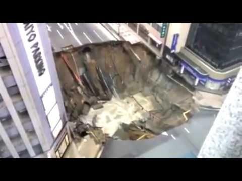 Caught on Camera! Giant Sinkhole swallows street in Fukuoka, Japan - YouTube