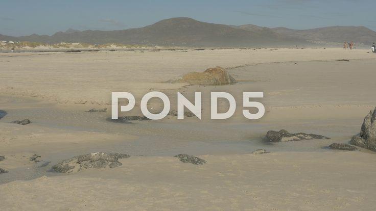 4K Sandy Beach  Rocks Sea Ocean Mountains - Stock Footage | by RyanJonesFilms