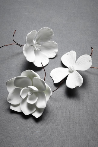 Porcelain blooms in dogwood, cherry blossom or magnolia with copper wire fasteners. $10 at bhldn.com. I purchased some locally at Noun and adore them.