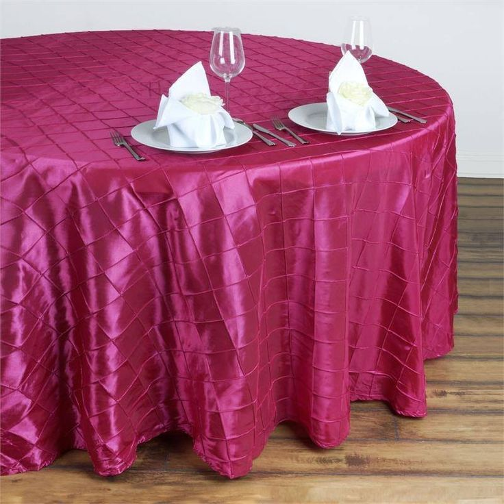 """Fushia Pintuck Tablecloths 132"""" Round - Pintuck is actually a fold of fabric that is stitched intricately to hold it in a place, very much like a pleat. These lovely pleats impart a decorative effect to the fabric by fashioning a visual line at a chosen point. They effortlessly bridge vintage and contemporary styles to create a majestic new classic look. If you do not want your celebration to blend in with other weddings, birthdays, and anniversaries, try our premium quality pintuck…"""