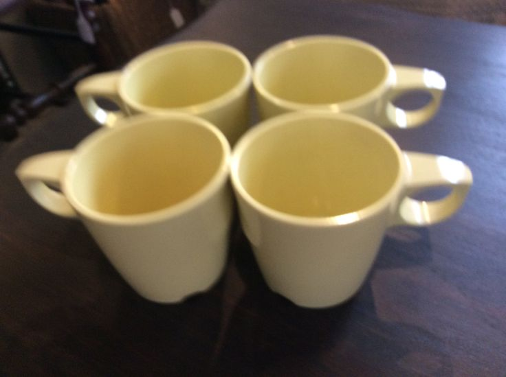 Melmac...Set of four...Butter yellow handled mugs by ConsignmentClassics on Etsy