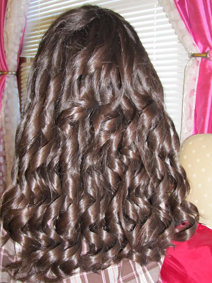 My daughter's hair done in ringlet curls for her Christmas show.