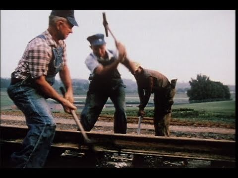 Gandy Dancers 1973. men working with cross ties, aligning the track, and spiking. The film focuses on the changes brought about by mechanization of railroad building. The film is part of the Burton Schrader collection in East Tennessee State University, Archives of Appalachia.