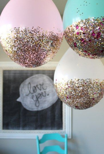 If this New Year's Eve you plan on partying like it's 2016 (read: you, the kids, a killer bottle of sparkling grape juice, and a 9 o'clock bedtime), it's still a cinch to pump up the celebration with fun and festive decor you can create with your little crafters. From a glittering pasta garland to a starry backdrop for holiday candids, flip through the slideshow below to discover easy decorations...