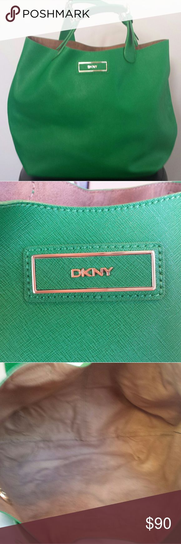 """DKNY Handbag HUGE DKNY in a splendid spring green. This bag has so much going on! 100% Genuine Saffiano Leather, the inside is unlined and finished in a beautiful tan suede.  Detachable insert to hold belongs securely, detachable shoulder strap and a lovely DKNY key fob. Measurements are 18"""" x 13""""  Bright and fresh - just in time for spring!   Unused and without tags. Has been sitting in my closet for a year so price is reflective. Bought it last spring and it is way to large for me. DKNY…"""