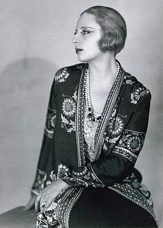 """(1898-1980) a Polish ART DECO painter and """"the first woman artist to be a glamour star"""". INFLUENCED by CUBISM, Lempicka became the leading representative of the Art Deco style across two continents, a favorite artist of many Hollywood stars, referred to as 'the baroness with a brush'. She was the most fashionable portrait painter of her generation among the haute bourgeoisie and aristocracy, painting duchesses and grand dukes and socialites."""