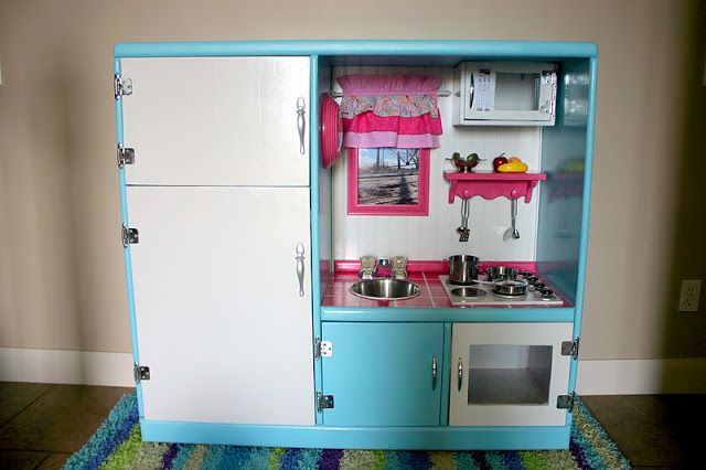 Turn an old entertainment center into a realistic play Realistic play kitchen