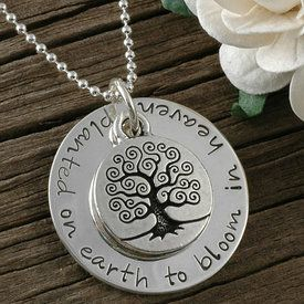 """A wonderful way to keep your little one or loved one close to your heart. The words """"planted on earth to bloom in heaven"""" are hand stamped on a 1"""" round silver pendant. A tree charm is placed over a hidden pair of baby feet. $74.00 http://www.wholesouljewelry.com/planted-on-earth-to-bloom-in-heaven-memorial-necklace-myra/"""