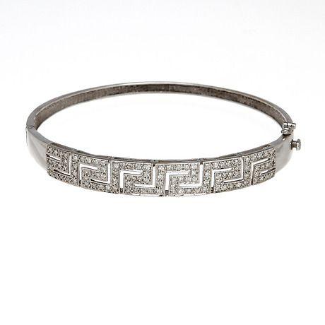 ARMRING, vitguld 18 k, diamanter, totalvikt 17,6 gram. Smycken & Ädelstenar - Armband – Auctionet