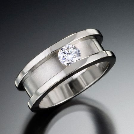 Pricing starts at $4,980. Eclipse ring is masculine and elegant. This unique men's ring design features a diamond set in white gold. Also available by order in white, yellow, or two-tone gold settings to accompany a variety of stone types and sizes. Call (949) 715-0953 to purchase or click below for additional information.