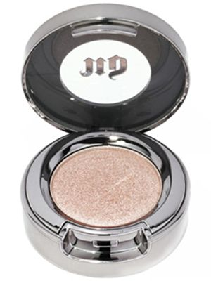 Urban Decay's eye shadow in Sin has a shimmering rose-gold color....