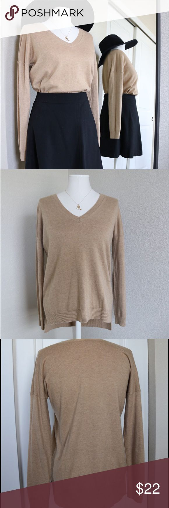 GAP - Soft Camel V-Neck Pullover Sweater GAP soft v-neck camel color pullover sweater is now up for grabs! The sweater is a size extra small, but fits slightly oversized in the body. The fit goes great when pulled over a button up collared blouse. If you want a looser fit, wear with on it's own or with a thin cami beneath. It's made mostly of nylon and won't shrink. Feel free to comment if you have additional questions. No trades but always open to negotiations! GAP Sweaters V-Necks