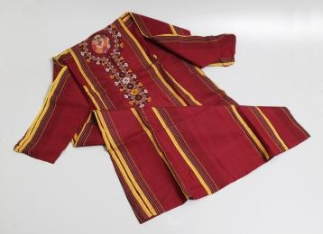 Traditional dress for the women of the Central Asian region, including nomadic Turkmen women, consists of a calf-to-ankle length dress (kurta), trousers and coat (khalat), all cut straight and wide. Neither the dress nor the coat have collars and the women generally cover their heads with cap and scarf. Although this Turkmen woman's dress is modern and has been made using a sewing machine, the colours and pattern are the traditional Turkmen favourites - dark red with a bright yellow stripe…