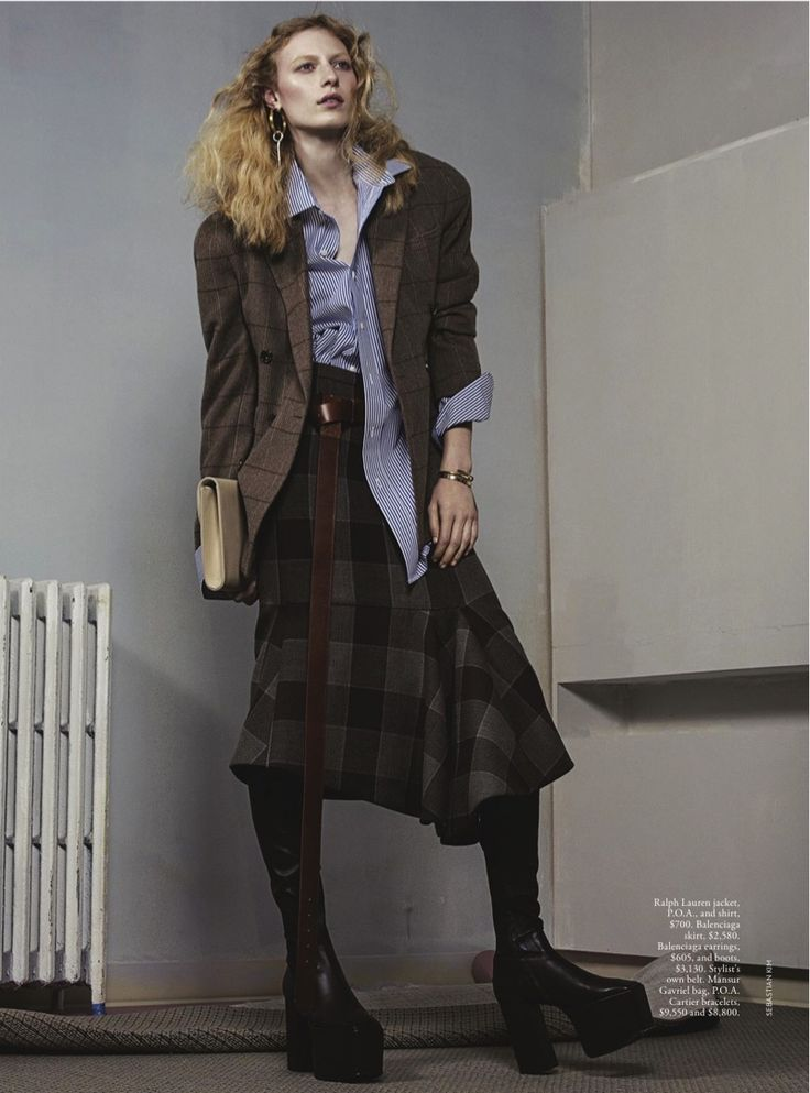 Layering up, Julia Nobis wears jacket and shirt with skirt and boots for Vogue Magazine Australia December 2016 issue