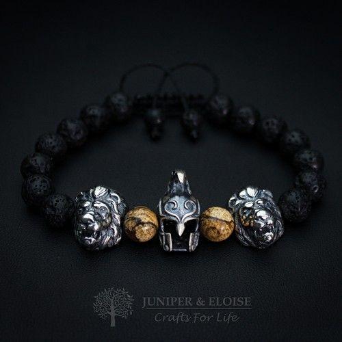 LION & HELMET CHARM BRACELETLION & HELMET CHARM BRACELET - This handmade bracelet is made with 8mm Lava and Brown Jasper beads, featuring 925 Silver Helmet charm accompanied with 2 large 925 Silver lion charms on both sides.