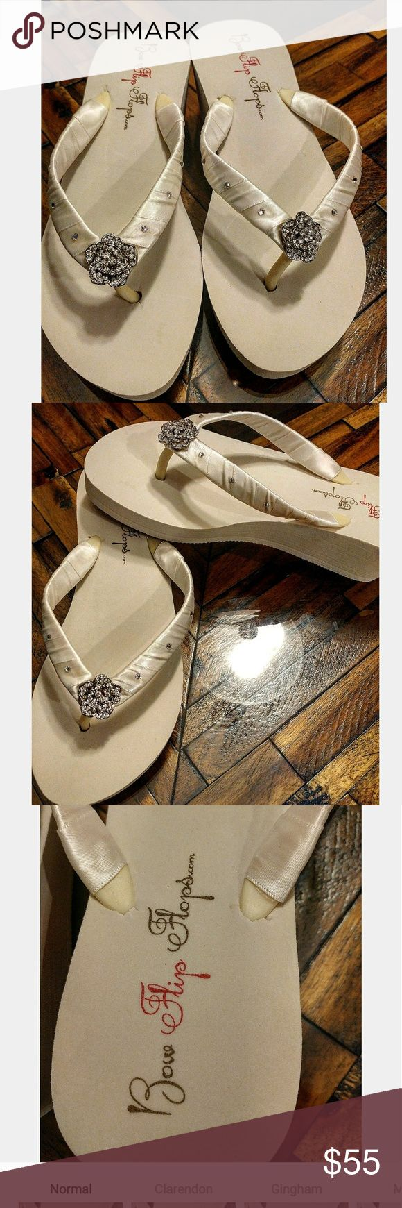 !Ivory wedding sandals Size 7 wedding sandals, NEW.  never worn.  Ivory in color, beautiful sparkling flower embellishments and sparkling studs.  Perfect for beach wedding or just to throw on at the reception!  So cute!!  bow flip flops Shoes Sandals