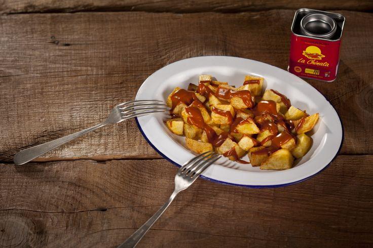 ... Ahumado La Chinata / Chips with Brava Sauce and Smoked Paprika Powder