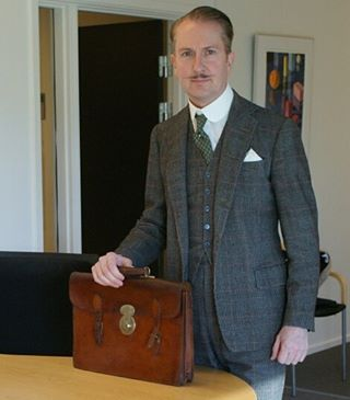 At the office;  presenting my new vintage 1940s Gentleman's briefcase.  The leather was quite worn, but soap and water, Renomat, mink oil renovator and leather polish did quite a difference. I love the deep patina. And the beautiful brass lock! My suit is a POW check flannel suit from 1955 by tailors Meyer & Mortimer. #vintage #1940s #gentlemans #briefcase #hogspear #attheoffice #vintage #bespoke #threepiece #flannel #suit #meyerandmortimer #sackvillestreet #savilerow