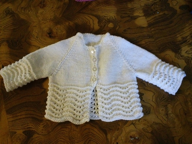 Ravelry: Feather and Fan Baby Sweater pattern by Lion Brand Yarn Knitting K...