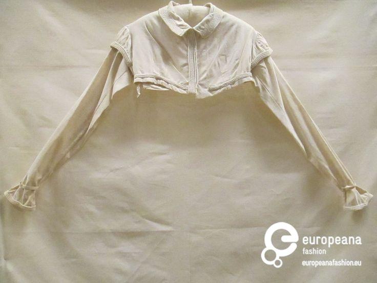 Spencer van wit katoen met ingeweven ruitje, cordonnerie over kraag, mouwen en lijfje