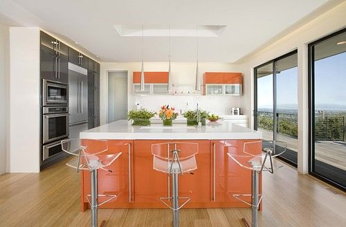 Shiny orange lacquer adds some spice to this contemporary kitchen.