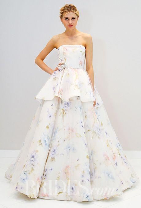 A tiered, floral wedding dress by @randirahm | Brides.com