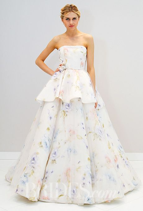 A tiered, floral wedding dress by @randirahm | Brides.com