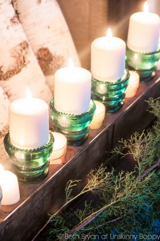 Glass insulators turned upside down for candle holders.  Such a creative idea!  Love it!!!