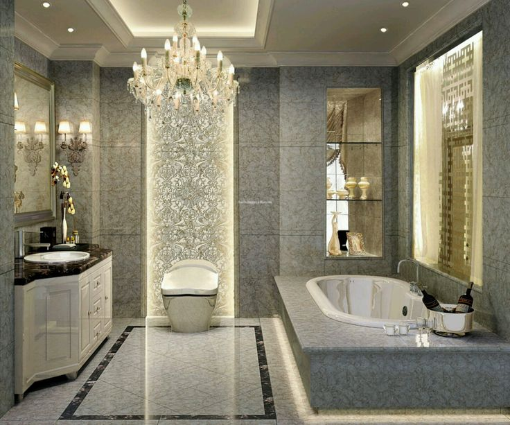 luxurious bathroom interior with white ceramic bathtub on modern tiles also round washbasin and ceiling crystal - Bathrooms Designer