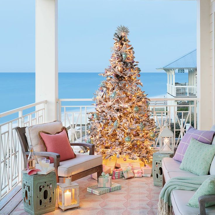 Christmas Tree on Porch... in Florida Home via Coastal Living: http://www.coastalliving.com/homes/decorating/blue-florida-christmas-house-tour/view-all Beach House Christmas Home Tour.
