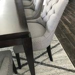 Transport your decor to a simpler time with the Regent Upholstered Dining Chair. Fashioned with a chic and elegant look, Regent Upholstered Dining Chair features finely tufted buttons, studded nailhead trim and a regal seat generously padded in foam. Regent Upholstered Dining Chair comes with non-marking foot caps, tapered wood legs and works well in both modern and traditional dining rooms.