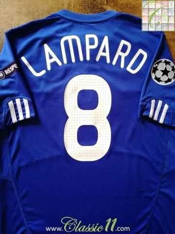 Official Adidas Chelsea home football shirt from the 2009/2010 season. Complete with Lampard #8 on the back of the shirt in European Cup lettering, Champions League star ball and UEFA Respect patches on the sleeves.