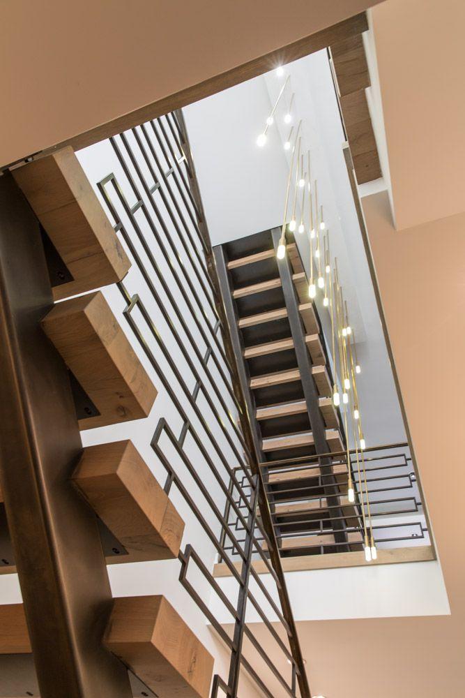 Custom Geometric Staircase With Water Drop Like Lights