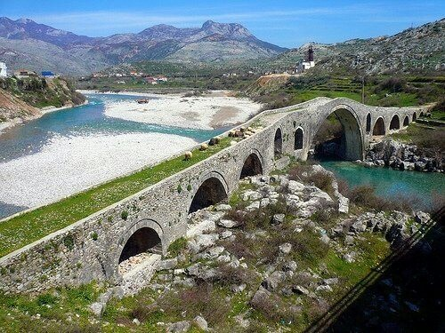 The Mes Bridge, built in the 18th century, Shkoder, Albania. Shkodër; historically also known as Scutari, is one of the oldest and most historic places in Albania, as well as an important cultural and economic center.