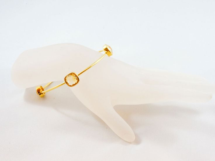 Citrine Gem Bangle - Sterling Silver 24kt gold micro plated bangle decorated with 4 round Citrine gem stones. Wear them Stack on or single. Perfect from day to night