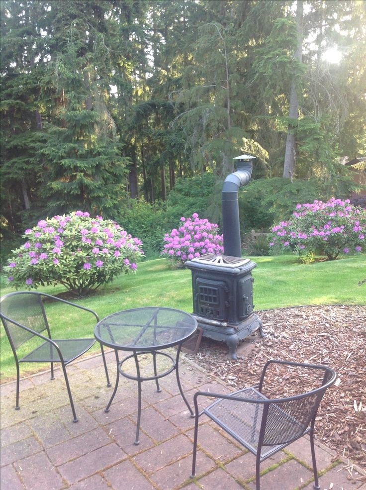 Back patio with the outside wood stove we use for cooking clams that we dug down at  our private community beach!