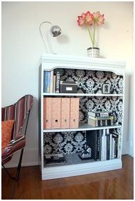 Wallpaper the back and insides of bookshelves.